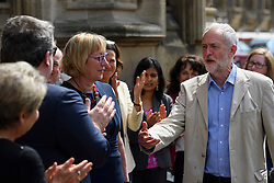 © London News Pictures. 09/05/2016. London, UK. Leader of the Labour Party, JEREMY CORBYN (right), greets new Labour MPs Chris Elmore (not pictured) and Gill Furniss (left) outside the Houses of Parliament in London following elections last week. Photo credit: Ben Cawthra/LNP