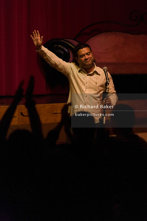 The stand-up comedian Paul Sinha performs at a comedy night in south London.