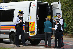 © Licensed to London News Pictures. 04/09/2019. London UK: Police officers arrest a protestor after cutting them free, Photo credit: Steve Poston/LNP