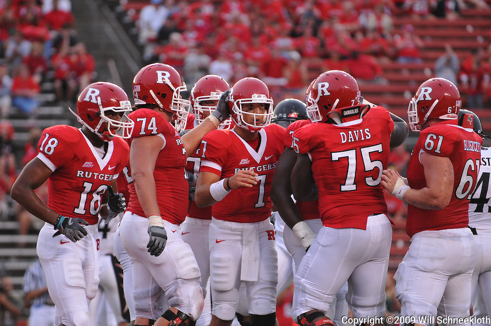Sep 7, 2009; Piscataway, NJ, USA; Rutgers quarterback Tom Savage (7) is congratulated on his first college touchdown pass, but Cincinnati would go on to defeat Rutgers 47-15 in NCAA Big East football at Rutgers Stadium.