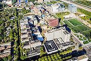 Nederland, Noord-Holland, Amsterdam, 27-09-2015; Zuid-as, overzicht campus van de Vrije Universiteit (VU) aan de Boelenlaan. Hoofdgebouw van de VU met links de subfaculteiten natuurwetenschappen en het Opleidingsinstituut Zorg en Welzijn (OZW). In de achtergrond Academisch Ziekenhuis Vrije Universiteit VUmc, VUmc Cancer Center, ACTA (tandheelkunde).<br /> Zuid-as, 'South axis', financial center in the South of Amsterdam, with University Vrije Universiteit). <br /> University Hospital VUmc (Vrije Universiteit) and VU MC Cancer Center. Amsterdam equivalent of 'the City', financial district. <br /> luchtfoto (toeslag op standard tarieven);<br /> aerial photo (additional fee required);<br /> copyright foto/photo Siebe Swart