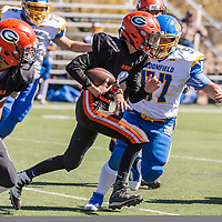 Photo - Jeffery Jones<br /> Gallup Bengal quarterback Isaiah Reece (2) runs the ball against the Bloomfield Bobcat defense during Saturday's JV match-up at Angelo PiDaulo Memorial Stadium in Gallup. The Bobcats won 48-8.