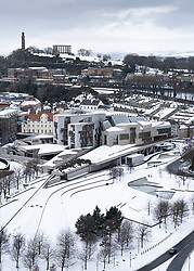 Winter view of Scottish Parliament buildings at Holyrood in the snow, Edinburgh, Scotland, UK