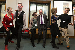 © Licensed to London News Pictures. 23/02/2015. London, England. Frank Doran MP dances with members of Dance UK. MPs attend a dance class with members of Dance UK and Lindy Hop dancers. Dance UK launches the 2015 Dance Manifesto with a beginners' social dance class hosted by the All Party Parliamentary Dance Group for all MPs at Portcullis House and led by teacher Jenny Thomas, charleston choreographer for the BBC's Strictly Come Dancing with Strictly professional dancer Robin Windsor. Photo credit: Bettina Strenske/LNP