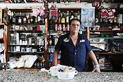 Domenico, 56 anni, commerciante del quartiere Tamburi. Il suo bar e poco distante dai parchi minerari. Christian Mantuano/OneShot