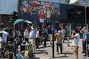 Following the attack on a group of Muslim men outside the Finsbury Park mosque which killed one person and seriously injured another ten, media crews gather below a large billboard featuring Arsenal football players, on 19th June 2017, in the borough of Islington, north London, England.