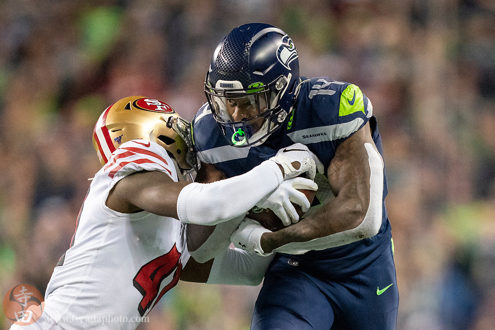 December 29, 2019; Seattle, Washington, USA; Seattle Seahawks wide receiver D.K. Metcalf (14) runs against San Francisco 49ers defensive back Emmanuel Moseley (41) during the fourth quarter at CenturyLink Field.