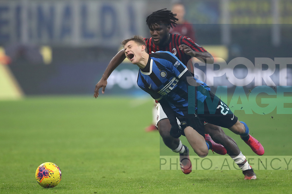 Nicolo Barella of Inter  falls to the ground in agony as Franck Kessie of AC Milan stands his foot of during the Serie A match at Giuseppe Meazza, Milan. Picture date: 9th February 2020. Picture credit should read: Jonathan Moscrop/Sportimage