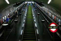 © Licensed to London News Pictures. 08/01/2013, London, UK. Passengers travel on the escalators in the Grade II listed St John's Wood underground station in London, Tuesday, Jan. 8, 2013. London Underground mark its 150 year anniversary on 9 January. In 1863 January 9 the world first underground train entered into public service. Photo credit : Sang Tan/LNP