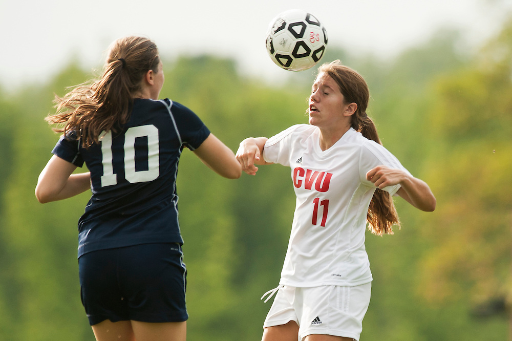 CVU's Anne Keen (11) heads the ball during the girls varsity soccer game between the Burlington Seahorses and the Champlain Valley Union Redhawks at CVU High School on Tuesday afternoon September 8, 2015 in Hinesburg. (BRIAN JENKINS/for the FREE PRESS)