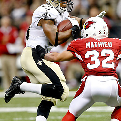 Sep 22, 2013; New Orleans, LA, USA; New Orleans Saints running back Pierre Thomas (23) is pursued by Arizona Cardinals defensive back Tyrann Mathieu (32) during a game at Mercedes-Benz Superdome. The Saints defeated the Cardinals 31-7. Mandatory Credit: Derick E. Hingle-USA TODAY Sports