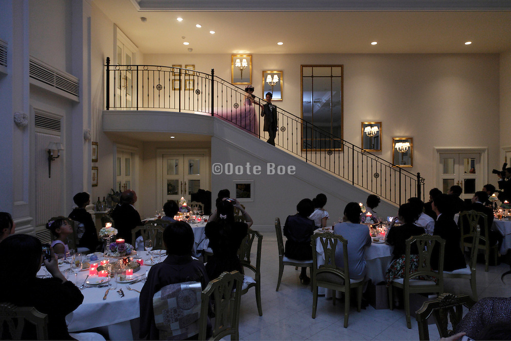 bride and groom coming down the stairs for their wedding celebration
