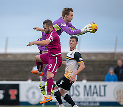 Arbroath's Ryan Wallace and Dumbarton's keeper Robbie Mutch. Arbroath 3 v 1 Dumbarton, Scottish Football League Division One played 20/10/2018 at Arbroath's home ground, Gayfield Park.