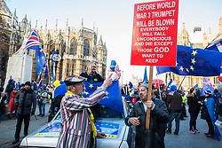 London, UK. 11th December, 2018. Pro- and anti-Brexit activists debate outside Parliament on the day on which a vote was originally to have been scheduled on completion of a House of Commons debate on the Government's draft Brexit withdrawal agreement.