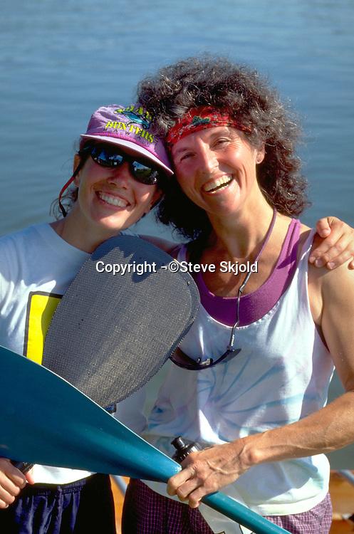 Happy volunteers age 26 and 49 at celebrating Courage Center Lake Nokomis canoe race fundraiser.  Minneapolis  Minnesota USA