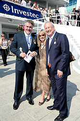 Left to right, RAYMOND VAN NIEKERK Global Head of Marketing at Investec and BERNARD KANTOR and his wife DAle he is CEO of Investec at the Investec Ladies Day at Epsom Racecourse, Surrey on 4th June 2010.