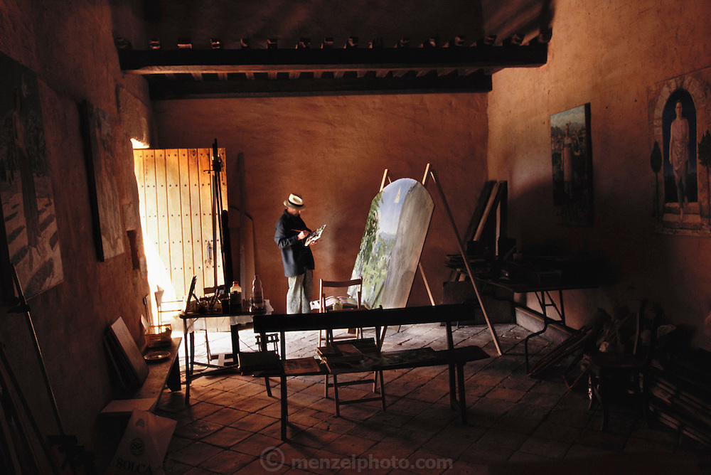 Basque artist Vincente Ameztoy, painter in residence at the Remelluri Winery, painting in an 11th century chapel.  Rioja, Spain.