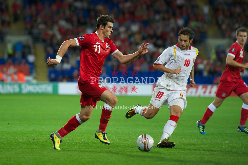 CARDIFF, WALES - Friday, September 2, 2011: Wales' Gareth Bale in action against Montenegro's Radomir Dalovic during the UEFA Euro 2012 Qualifying Group G match at the  Cardiff City Stadium. (Pic by David Rawcliffe/Propaganda)
