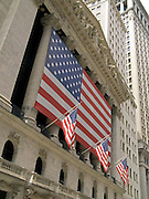 the very large American flag draped over the pillars of the NY Stock Exchange