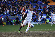 Tranmere Rovers' Matthew Pennington under pressure from Carlisle United's Lewis Guy. Skybet football league 1 match, Tranmere Rovers v Carlisle United at Prenton Park in Birkenhead, England on Saturday 29th March 2014.<br /> pic by Chris Stading, Andrew Orchard sports photography.
