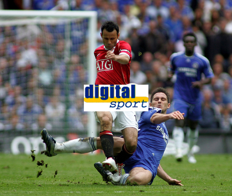 Photo: Paul Thomas.<br /> Chelsea v Manchester United. The FA Cup Final. 19/05/2007.<br /> <br /> Ryan Giggs (Red) of Utd gets tackled by Frank Lampard.