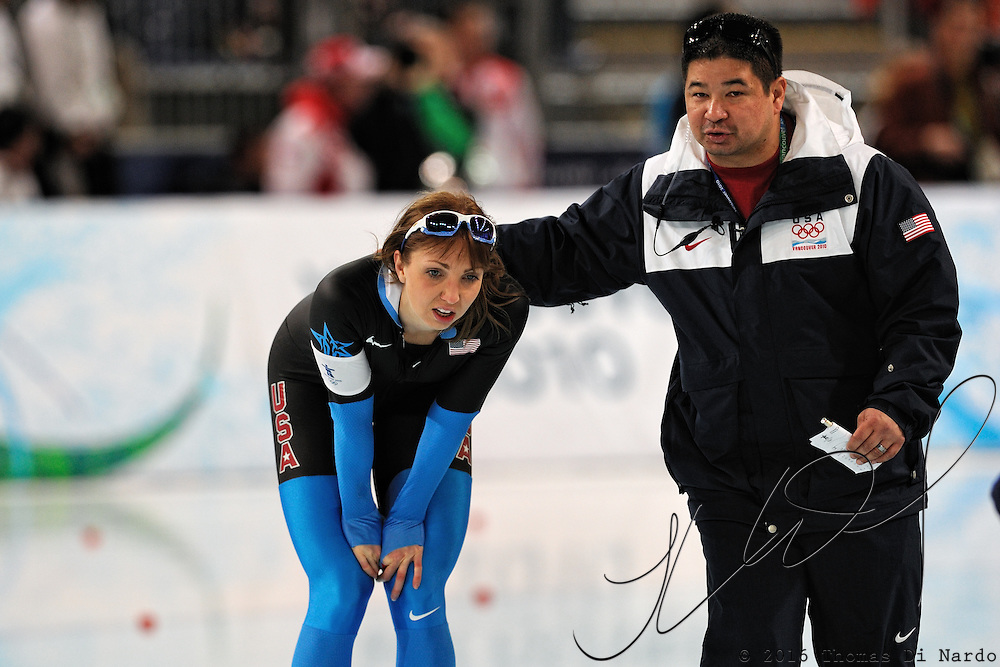 February 17, 2009 - 2010 Winter Olympics - Speedskating - US Team coach Ryan Shimabukuro talks with Rebekah Bradford after she skated in the 1000m distance held at the Richmond Olympic Oval.