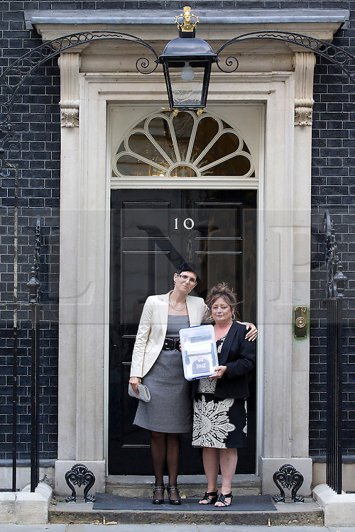 """© Licensed to London News Pictures. 31/08/2013. London, UK. Lorraine Etheringon (L) and Lorraine Salvage (R), the sister and cousin (respectively) of prisoner Charles Bronson are seen on the doorstep of Number 10 Downing Street shorty before handing in a petition for his release in London today (31/08/2013). Often referred to in the British press as the """"most violent prisoner in Britain"""", Bronson is currently being held on a life sentence in Wakefield High-Security Prison. Photo credit: Matt Cetti-Roberts/LNP"""