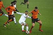 Luciano Narsingh of Swansea city holds off a challenge from Roderick Miranda of Wolverhampton Wanderers (r).  The Emirates FA Cup, 3rd round replay match, Swansea city v Wolverhampton Wanderers at the Liberty Stadium in Swansea, South Wales on Wednesday 17th January 2018.<br /> pic by  Andrew Orchard, Andrew Orchard sports photography.