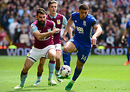 Che Adams of Birmingham battles with Mile Jedinak of Aston Villa (l). EFL Skybet championship match, Aston Villa v Birmingham city at Villa Park in Birmingham, The Midlands on Sunday 23rd April 2017.<br /> pic by Bradley Collyer, Andrew Orchard sports photography.
