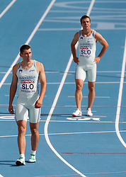 Gregor Kokalovic as fourth and Bostjan Fridrih as third Slovenia sprinter disappointed after the 4x100m Mens Relay Heats during day five of the 20th European Athletics Championships at the Olympic Stadium on July 31, 2010 in Barcelona, Spain.  (Photo by Vid Ponikvar / Sportida)