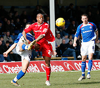 Sebastien Grimaldi (left) Chesterfield clears under pressure from Junior Agogo (right) of Nottingham Forest