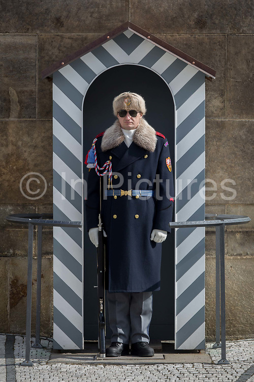 A guard wears the Ruritanian-style uniform outside Prague Castle, at Hradcany-Prazsky Hrad Prague Castle, on 18th March, 2018, in Prague, the Czech Republic. Ater the Velvet Revolution in 1990 when the communist regime ended, Václav Havel, the first President of the Czech Republic wanted his guards's uniforms to be different from the khaki ones the communists wore and the basic ones found in neighboring countries. Havel chose Theodor Pistek, the Czech born artist and costume designer who won an Academy Award for Best Costume Design for the 1984 film Amadeus.