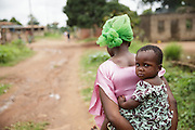 Christine Koné, 26, walks back home with her daughter Ruth Dablé, 2, in the town of Katiola, Cote d'Ivoire on Friday July 12, 2013. Christine underwent FGM as a child and now suffers from incontinence. She says she would never allow her daughter to undergo the procedure.