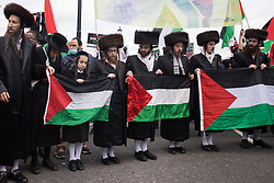 Ultra-Orthodox anti-Zionist Haredi Jews from Neturei Karta UK stand holding Palestinian flags during the National Demonstration for Palestine on 22nd May 2021 in London, United Kingdom. The demonstration was organised by pro-Palestinian solidarity groups in protest against Israel's recent attacks on Gaza, its incursions at the Al-Aqsa mosque and its attempts to forcibly displace Palestinian families from the Sheikh Jarrah neighbourhood of East Jerusalem.