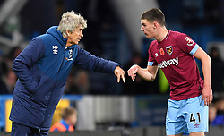 West Ham United manager Manuel Pellegrini (left) and Declan Rice talk tactics during the Premier League match at the John Smith's Stadium, Huddersfield