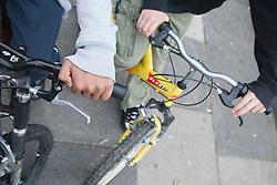 Boys on bikes - hands on handlebars.
