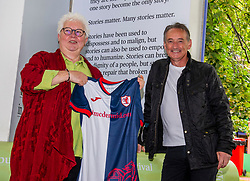 Pictured: <br />Val McDermid presents Pat Nevin withn a Raith Rovers strip as a memento of their meeting while Val's beloved Raith Rovers were playing Aberdeen.  <br /><br />Patrick Kevin Francis Michael Nevin is a Scottish retired footballer. In a 20-year career, he played for Clyde, Chelsea, Everton, Tranmere Rovers, Kilmarnock and Motherwell as a winger. He won 28 caps for Scotland, scattered across a ten-year international career, and was selected for the UEFA Euro 1992 finals squad.<br /><br />Val McDermid, FRSE, FRSL is a Scottish crime writer, best known for a series of novels featuring clinical psychologist Dr. Tony Hill in a grim sub-genre that McDermid and others have identified as Tartan Noir. At Raith Rovers football stadium, a stand has been named after McDermid. <br /><br />Ger Harley | EEm 15 August 2021