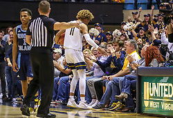 Dec 1, 2019; Morgantown, WV, USA; West Virginia Mountaineers forward Emmitt Matthews Jr. (11) celebrates with fans after a turnover from Rhode Island Rams late in the second half at WVU Coliseum. Mandatory Credit: Ben Queen-USA TODAY Sports