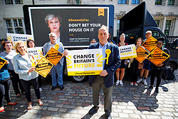 """© Licensed to London News Pictures. 03/06/2017. London, UK. SIMON HUGHES, Liberal Democrat candidate and former Southwark & Old Bermondsey MP reveals a new poster of Theresa May accompanied by the words: """"Don't bet your house on it"""" to criticise the so called """"dementia tax"""" in central London on Saturday 3 June 2017. Photo credit: Tolga Akmen/LNP"""