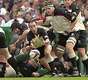 © Peter Spurrier / Sportsbeat images<br />email images@sportsbeat.co.uk - Tel +44 208 876 8611<br />Photo Peter Spurrier 02/05/2003<br />2003 - Zurich Premiership Rugby - Leicester Tigers v London Irish<br />Exiles scrum half, Hentie Martens, supported by Ryan Strudwick, clears the ball from scrum.