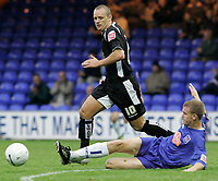Photo: Dave Howarth.<br />Stockport County v Swansea City. The FA Cup.<br />05/11/2005.  Swansea's Lee Trundle (L) skips past Stockport's Ross Greenwood