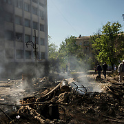 Burning debris outside a government building after clashes in Mariupol.