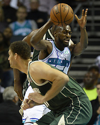 October 17, 2018 - Charlotte, NC, USA - The Charlotte Hornets' Kemba Walker (15) passes around the defense of the Milwaukee Bucks during the first half at the Spectrum Center in Charlotte, N.C., on Wednesday, Oct. 17, 2018. (Credit Image: © David T. Foster Iii/Charlotte Observer/TNS via ZUMA Wire)