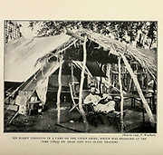 Sir Harry Johnston In A Camp On The Upper Shire, [Rhodesia] Which Was Besieged At The Time (1893) By Arab And Yao Slave Traders From the Book '  Britain across the seas : Africa : a history and description of the British Empire in Africa ' by Johnston, Harry Hamilton, Sir, 1858-1927 Published in 1910 in London by National Society's Depository