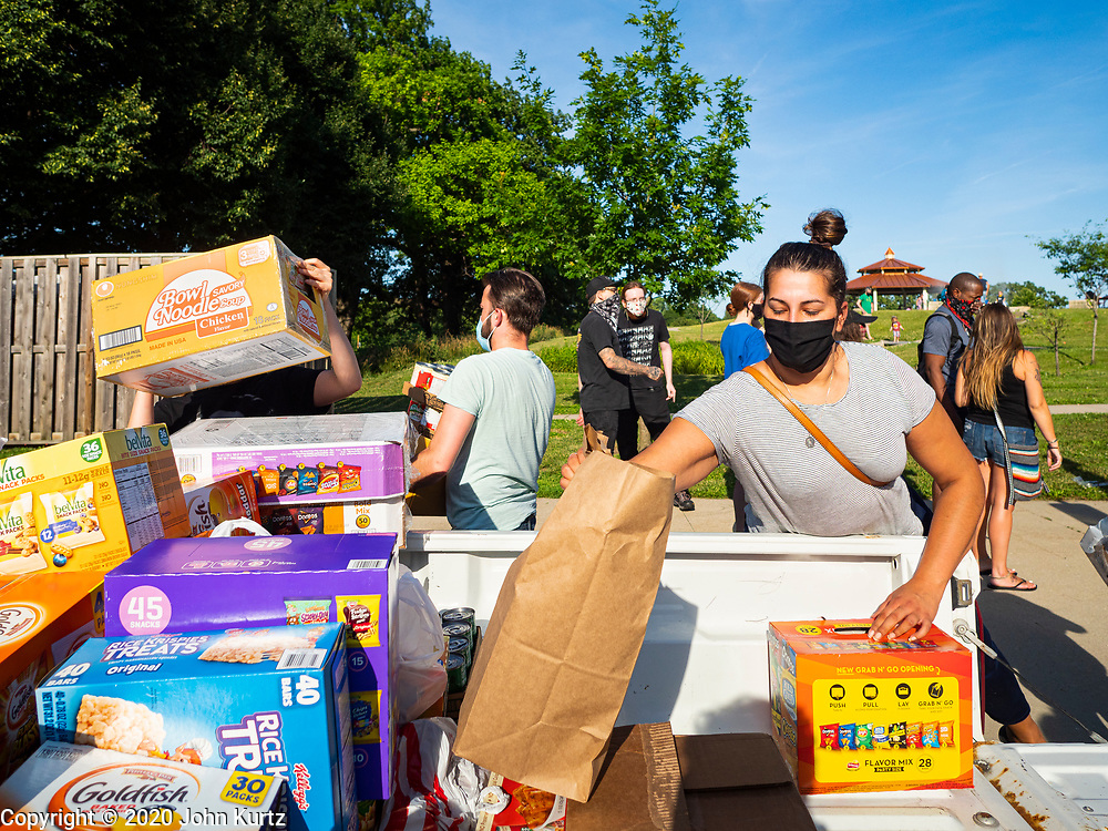 25 JUNE 2020 - DES MOINES, IOWA: Supporters of Black Lives Matter unload a truck of groceries donated to BLM to help the homeless. Nearly 100 volunteers came to a community support event organized by Black Lives Matter in Good Park in Des Moines. They sorted supplies donated to BLM, including food, sanitary supplies, first aid supplies, batteries, blankets, tents, and bottled water. The emergency packages will be distributed to homeless people in Des Moines.        PHOTO BY JACK KURTZ