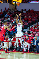 NORMAL, IL - December 18: Jaycee Hillsman shoots a 3 over Michael Diggins during a college basketball game between the ISU Redbirds and the UIC Flames on December 18 2019 at Redbird Arena in Normal, IL. (Photo by Alan Look)