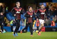 Manchester United's Shinji Kagawa (centre) warms up with team-mates Darren Fletcher (left) and Michael Carrick before the game