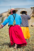 Native Uru women on the Floating islands of Lake Titicaka, Puno, Peru, South America