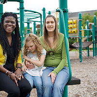 At a park in Norwich, Supportive Housing program case worker, Rose (in yellow) spends time with client Julia and Julia's daughter Annabella, age 5.<br /> <br /> Julia, 33, was raised in an abusive household and she entered foster care at the age of 9. Julia's mother was mentally ill and her father was sent to prison. As a teenager, Julia began suffering from depression. Lonely and in search of company, Julia entered a six-year, often-abusive relationship when she was only 13 years old. By the time she was 15, Julia had moved in with her older sister who became her foster parent. Julia's depression got worse, she started self-medicating with cannabis and at age 17 dropped out of school. Two years later, her mother suddenly died and Julia found life increasingly unbearable. She contemplated suicide but didn't seek help for her depression. Then Julia met Richard with whom she has shared a relationship that continues 14 years later. <br /> <br /> During what Julia describes as a traumatic period three years ago, she and Richard were arrested in a domestic dispute. The couple, by this time parents to a two year old daughter called Annabella, lost their apartment and Julia once again moved in with her sister, taking Annabella with her. The Department of Children and Families (DCF) were alerted and encouraged Julia to seek the assistance of the Supportive Housing program. In November 2014, Julia was introduced to Rose who became her case manager at the program. By January 2015, Rose had helped Julia secure an apartment subsidised by Supportive Housing. Rose offered emotional and material support, using funds to help Julia furnish her new home that was close to amenities including a park and laundromat. <br /> <br /> Rose introduced Julia to United Community Family Services who provided bus passes, signed her up with social security, disability allowance, state cash-assistance, counselling and medication-management. Never having lived with the support of a stable family mea