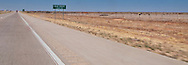 Deaf Smith County line sign along Interstate 20 in flat rural Texas panhandle panorama
